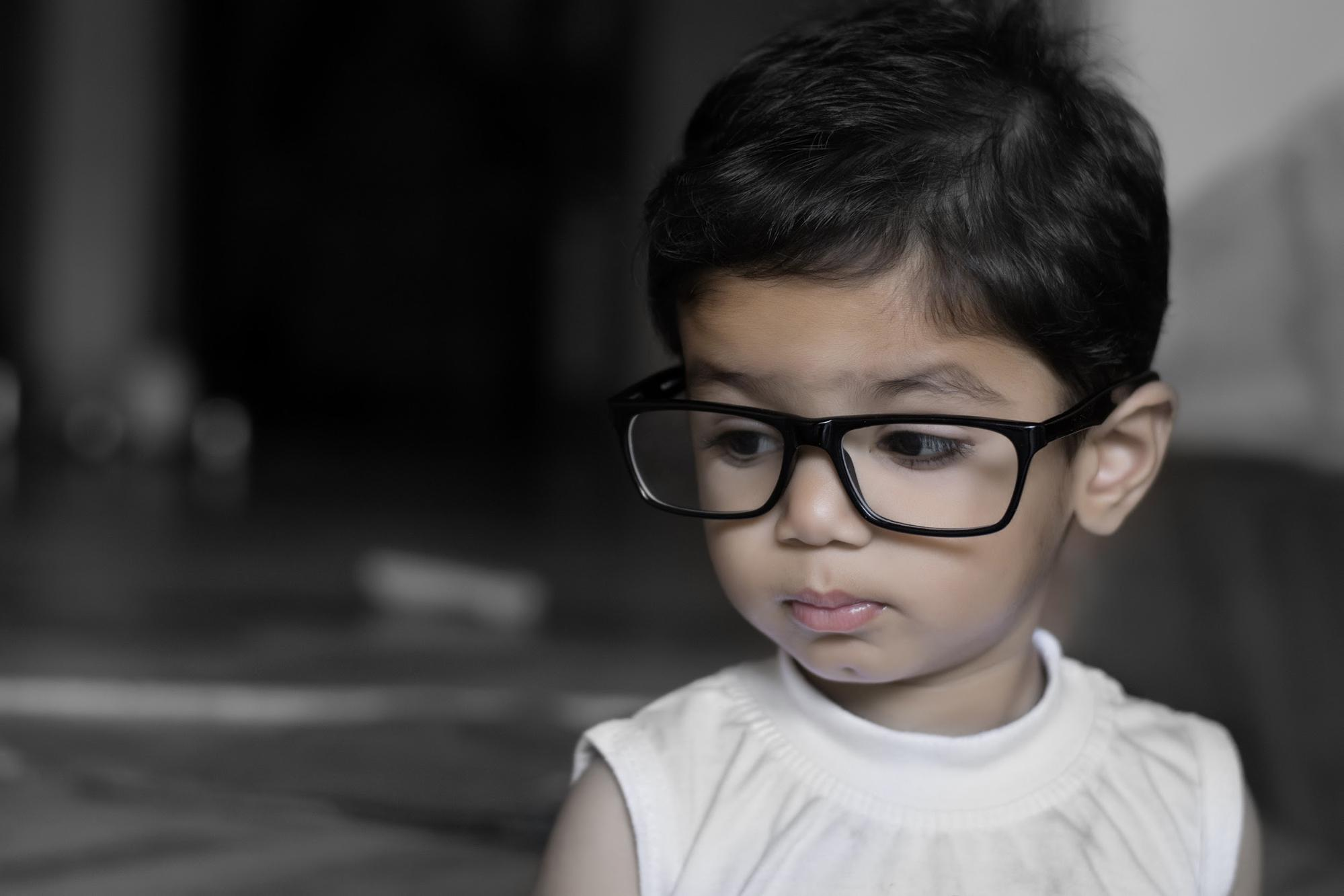 toddler in glasses ignoring body language